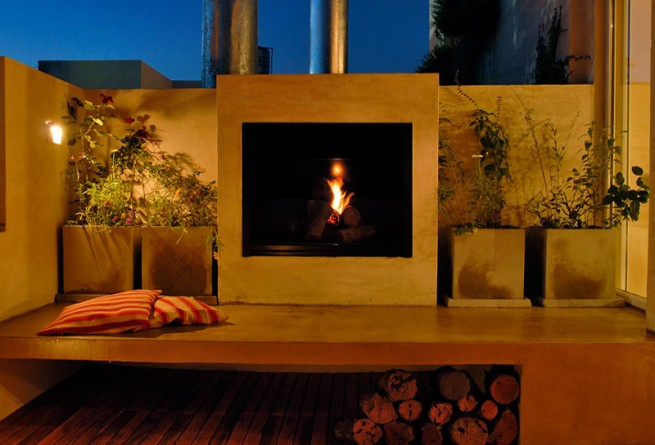 Poolside suite fireplace on balcony